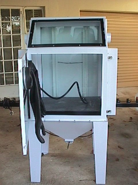 Sandblast Cabinet showing interior with sandblast gun